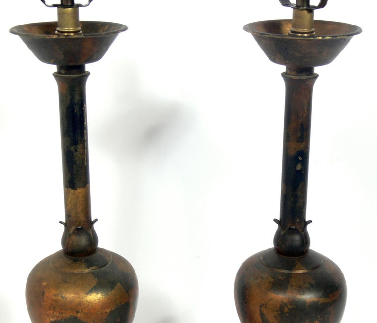 Chinese Pair of Distressed Gilt Metal Asian Lamps For Sale