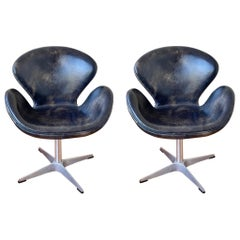 Pair of Distressed Leather on Swivel Base