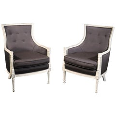 Pair of Distressed Painted Black Upholstered French Louis XVI Bergère Chairs