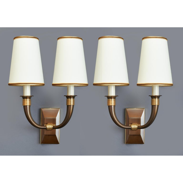 Dominique Andre Domin (1883-1962) & Marcel Genevriere, (1885-1967) An exquisite pair of two branch sconces in contrasting oxidized and polished bronze, with ringed tapered arms, France, 1940s. Ref: Dominique by Felix Marcilhac, p. 303 Rewired