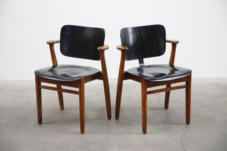 This incredible pair of Ilmari Tapiovaara 'Domus' armchairs (also called The Finn Chair in the US) was made in Finland, circa 1947, and very collectible and a fantastic example of early Mid-Century Modern design. Tapiovaara created this design for