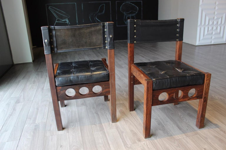 Pair of Don Shoemaker dining chairs, original leather on the seat and back, reversible seat and original buttons too. Born in Nebraska, Don S. Shoemaker studied painting at The Fine Arts Institution of Chicago. In the late 1940s, he moved to Mexico