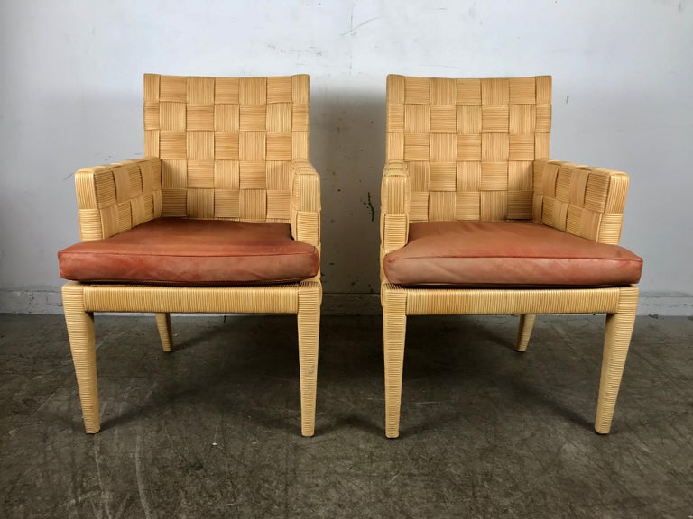 A fabulous pair of armchairs from the limited production Block Island collection designed by John Hutton (1947-2006) for Donghia, circa 1995.Chairs retain original leather seats, Extremely comfortable, examples from this particular series are nearly