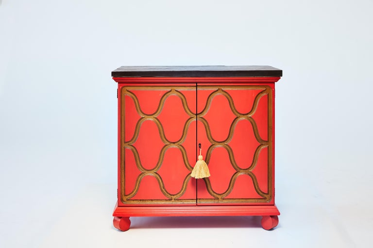 A pair of one-of-a-kind cabinets designed by Dorothy Draper (1889-1969) - America's most famous decorator - for her España line. After touring Spain for inspiration, Dorothy Draper produced her most sought after and iconic pieces: the España