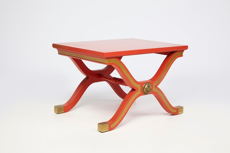 Pair of Dorothy Draper España collection side tables designed for Heritage Henredon. Red lacquer tables with gold highlighted details and brass medallions. Part of our extensive collection of Dorothy Draper furnishings. Note tables currently set to