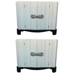 Pair of Dorothy Draper Serpentine Chests in Ivory Lacquer with Nickel Pulls