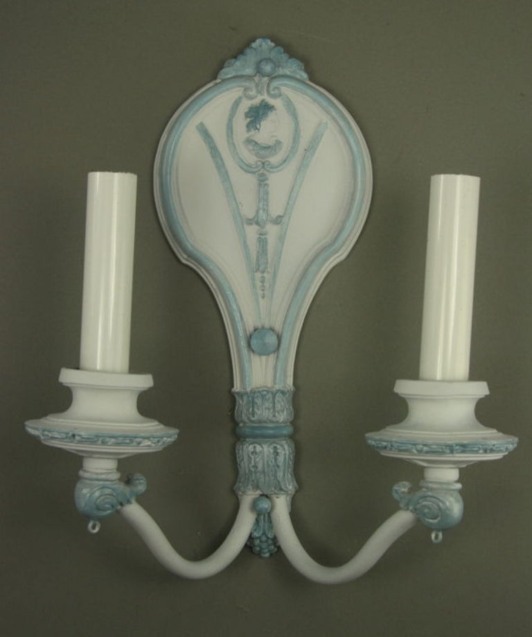 1-4069 pair of 1920s double arm hand painted in a white-pale blue color.
