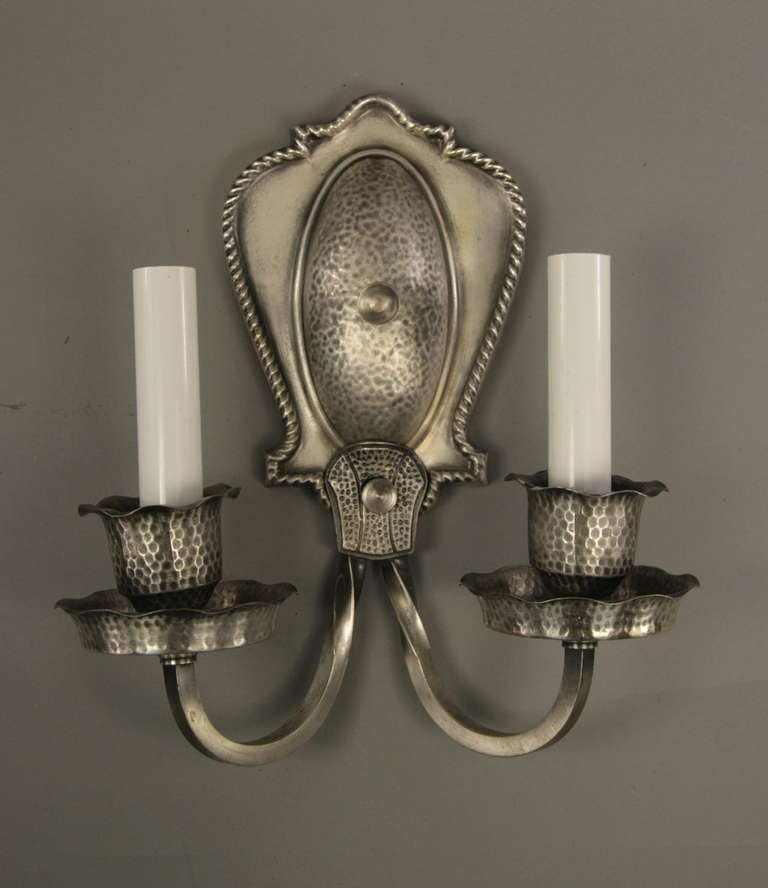 1-4060 a pair of 1920s silver plated hammered double arm sconces.