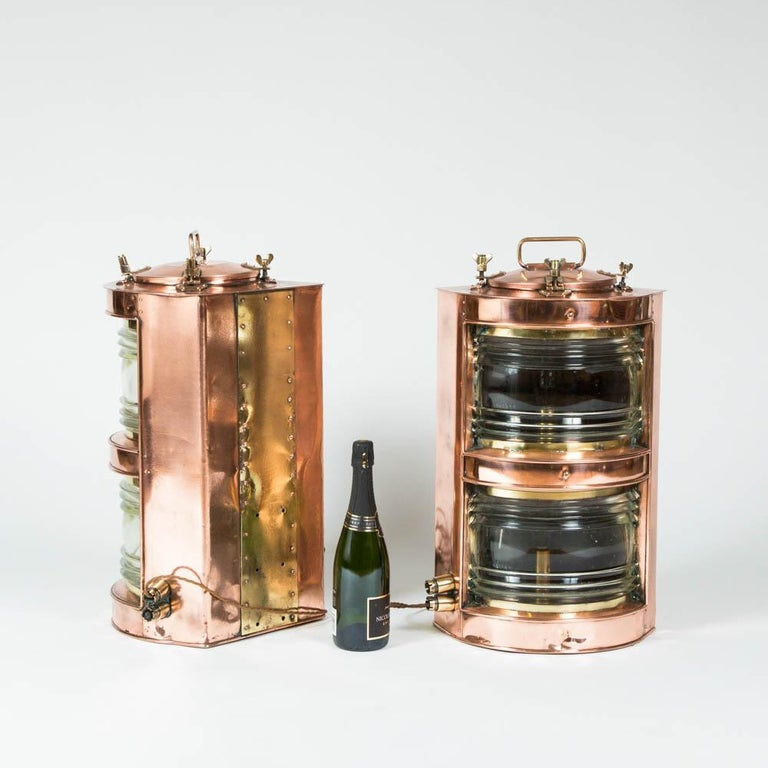 A pair of double-stack copper ships lights, port and starboard. 