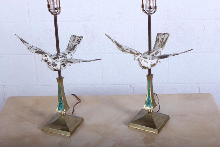 A rare pair of brass dove lamps designed by Pepe Mendoza.