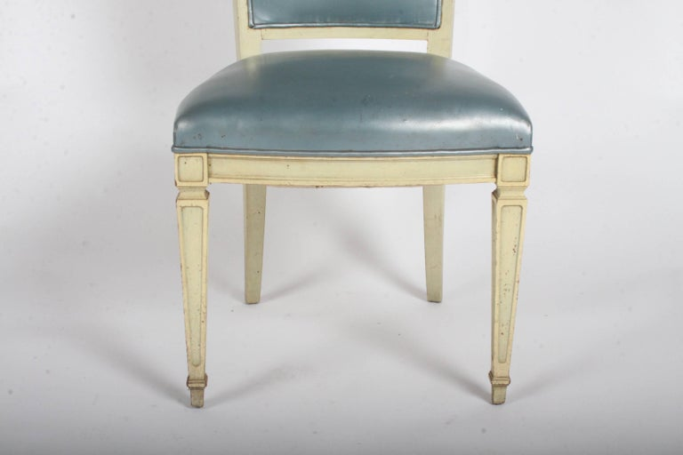 Pair of dramatic high back Hollywood Regency occasional or dining chairs. Gustavian design or neoclassical style tall ladder back with tapered form on elegant legs. In need of re-upholstery and refinishing. Measures: Seat height 17.5