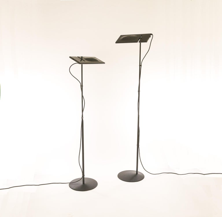A pair of halogen floor lamps Duna designed by Mario Barbaglia and Marco Colombo for PAF Studio.  Noticeable details of this early edition:sliding dimmer on the side of the shade (instead of on the electrical cord), the subtle curves in the shade