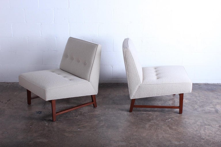 A pair of beautifully restored slipper chairs with mahogany frames. Designed by Edward Wormley for Dunbar.