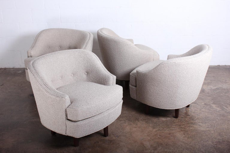 A pair of swivel chairs on walnut bases. Designed by Edward Wormley for Dunbar. Fully restored and upholstered in Rubelli boucle fabric. Two pair available.