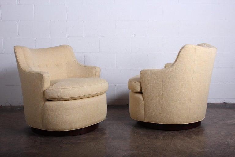Fabric Pair of Dunbar Swivel Chairs by Edward Wormley