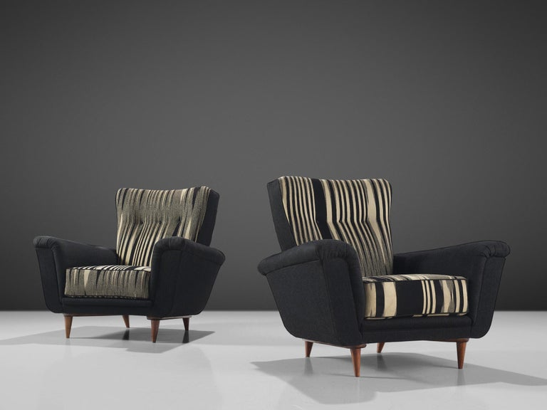 Artifort, set of two lounge chairs, black and white fabric, wood, The Netherlands, 1950s.  This set of chairs is an iconic example of Dutch design from the 1950s. The design is on the one hand simplistic, with elegant, subtle lines. On the other