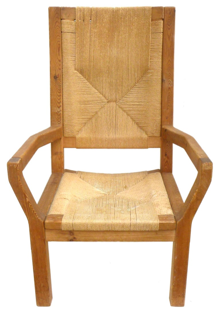 A fantastic pair of Dutch, wood and woven-twine highback armchairs. Handsome, well-built forms with unexpected angles, wonderful woodgrain, and an ample, comfortable seating area. Great, impressive scale and proportions; a classic mix of materials