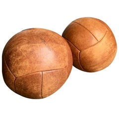 Pair of Dutch tan leather medicine exercise gymnasium balls circa 1970`s