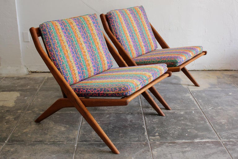 Beautiful pair of original DUX scissor lounge chairs designed by Swedish designer Folke Ohlsson, circa 1960s. The chairs have their original upholstery. Great colorful mod design. Reminds me of Jack Lenor Larsen or Missoni fabric. Some light fading