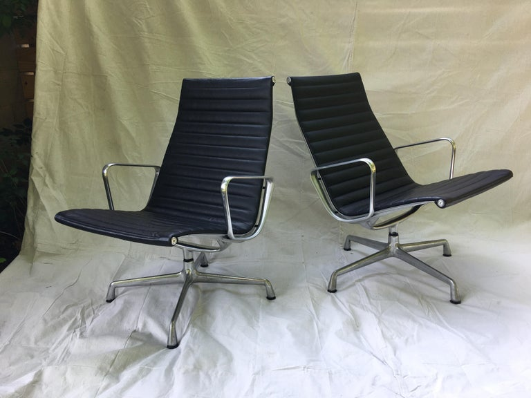 Pair of Eames aluminum group leather lounge chairs. Very nice to find a pair in Leather, usually fabric or vinyl! Very clean with minimal wear! Very comfy, chairs swivel, aluminum arms are clean showing minimal wear.
