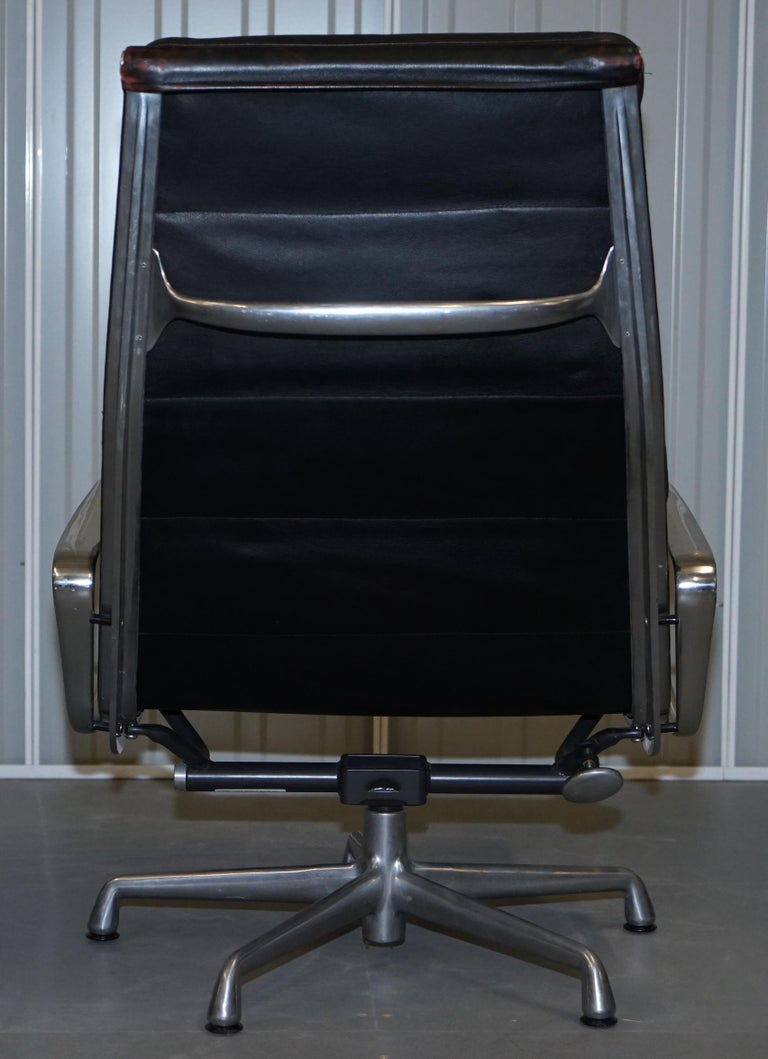 Hand-Crafted Pair of Eames EA 222 Herman Miller Leather Recliner Lounge Armchairs & Ottomans For Sale