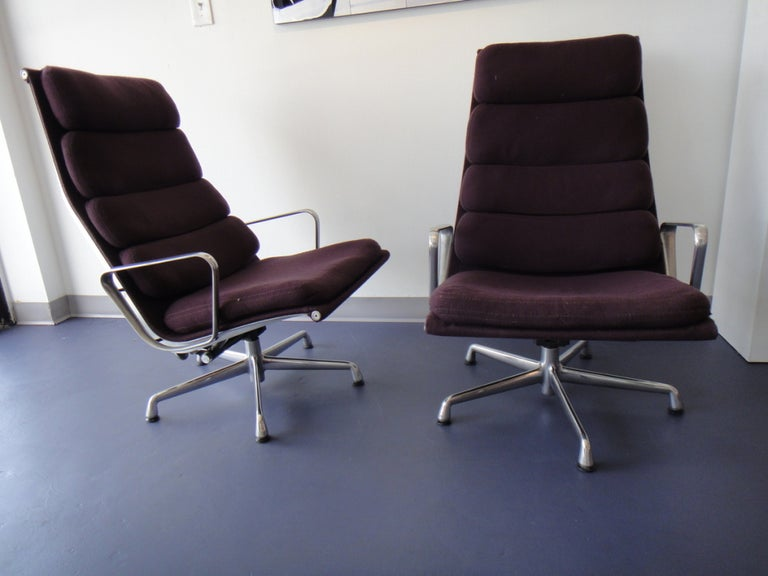 Pair of Mid-Century Modern soft pad management lounge chairs from the Aluminium Group Collection designed by Charles &Ray Eames and made by Herman Miller. Dark purple fabric with aluminium base and swivel/tilt mechanism original fabric and