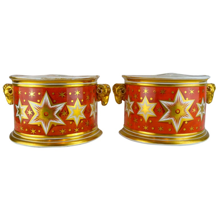 Pair of English early 19thcentury Worcester demmi=lune bough pots feraturing a rare orange ground with central band of gilded six pointed stars on a white ground.   The painting and gilding of the Chamberlains Worcester factory met the highest