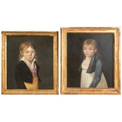 Pair of Early 19th Century Primitive Paintings, Portraits of a Boy and Girl