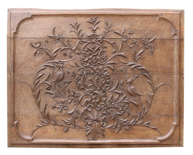 These oak panels are very deeply carved and have a waxed finish. They were reclaimed from a panelled room. Weight: 10 kg.