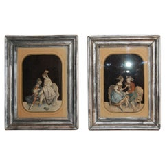 Pair of Early 19th Century French Cut-Out Passe-Partouts on Older Silvered Frame