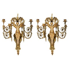 Pair of Early 19th Century Italian Neoclassical Gilt Figural Six-Light Sconces