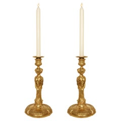 Pair of Early 19th Century Louis XVI Style Ormolu Candlesticks