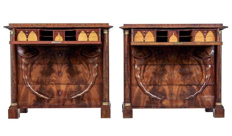 Pair of early 19th century mahogany Biedermeier secretaire commodes circa 1830.