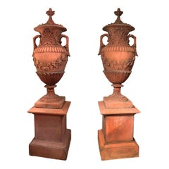 Pair of Early 19th Century Neoclassical Terracotta Urns and Lids on Plinth Bases