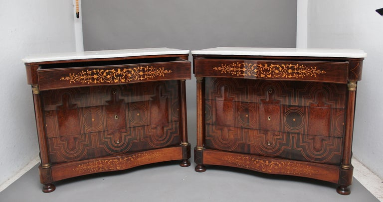 A fabulous pair of Spanish (mallorcan) early 19th century marble top commodes of serpentine form, inlaid and veneered in exotic woods such as rosewood, walnut, yew wood and boxwood, having the original white marble tops above a frieze drawer with