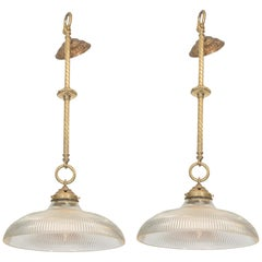 Pair of Early 20th Century Brass Pendants with Holophane Glass Shades