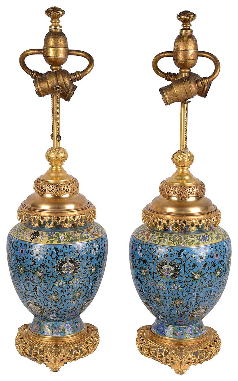 A very good quality pair of late 19th century Chinese cloisonné enamel and gilded ormolu vases / lamps. Each with wonderful classical bold colours, scrolling motif and foliate decoration.