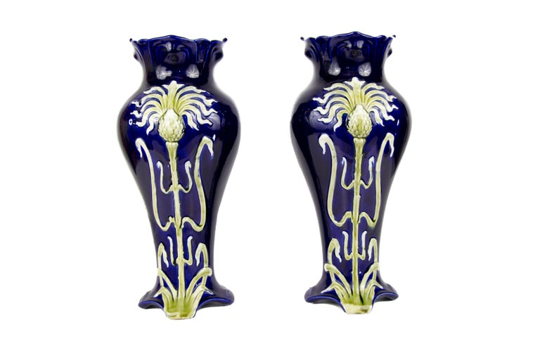 Pair of impressive French Art Nouveau majolica vases by Jean Bernard De Bruyne, circa 1900. The very decorative Art Nouveau vases are in a very good condition for the age. One of the vases has a small chip on bottom on the edge, please, see the