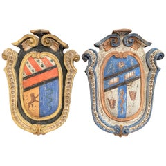 Pair of Early 20th Century French Carved Painted Wall Hanging Shields with Crest