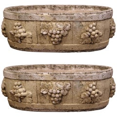 Pair of Early 20th Century French Carved Stone Planters with Grape Decor