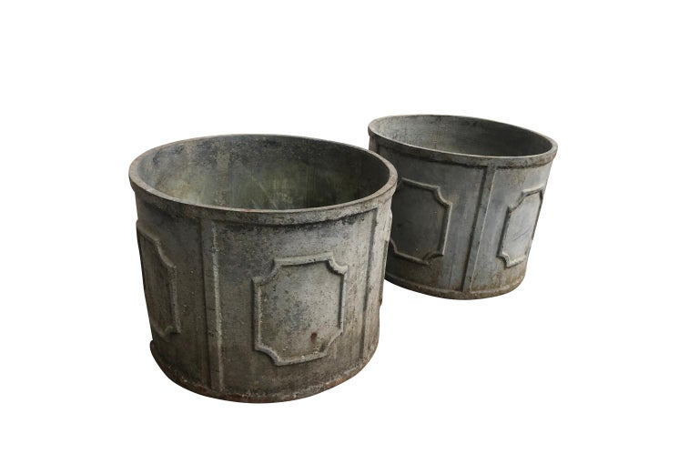 A very handsome pair of early 20th century jardinières from the South of France. Wonderfully constructed from patinated cast iron. Beautiful for any garden or interior.