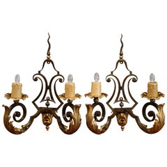 Pair of Early 20th Century French Louis XV Painted Iron Two-Light Wall Sconces