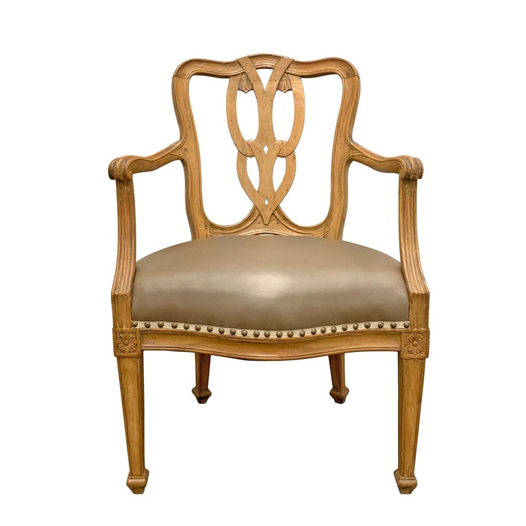 A fantastic pair of early 20th century Italian maple armchairs with a beautiful backsplat carved to mimic interlocking loops, generous wide seats, tapered square legs, and new taupe leather upholstery with linen tape and bronze nailhead