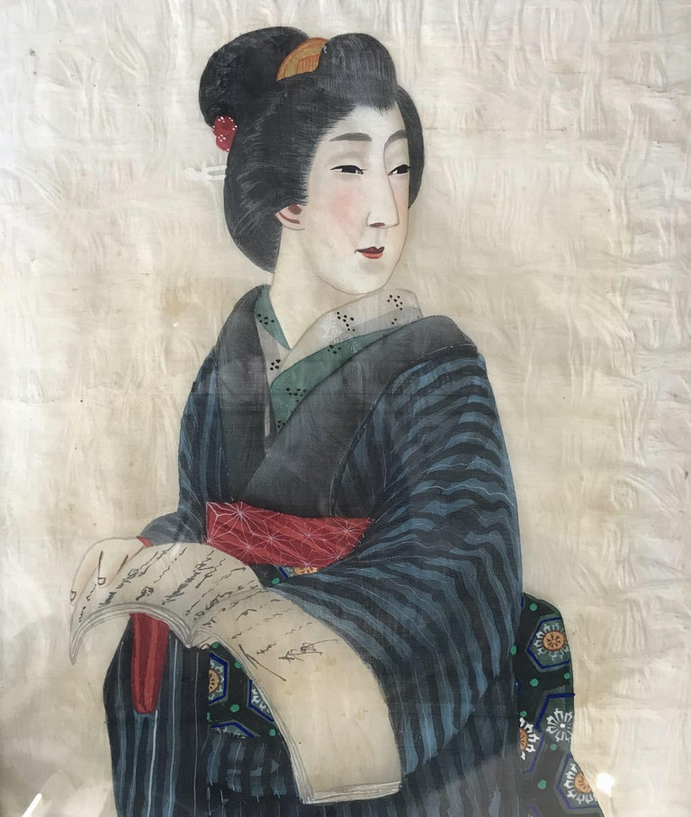 Two portraits of Japanese man and women in traditional costume painted on silk in their original frames.