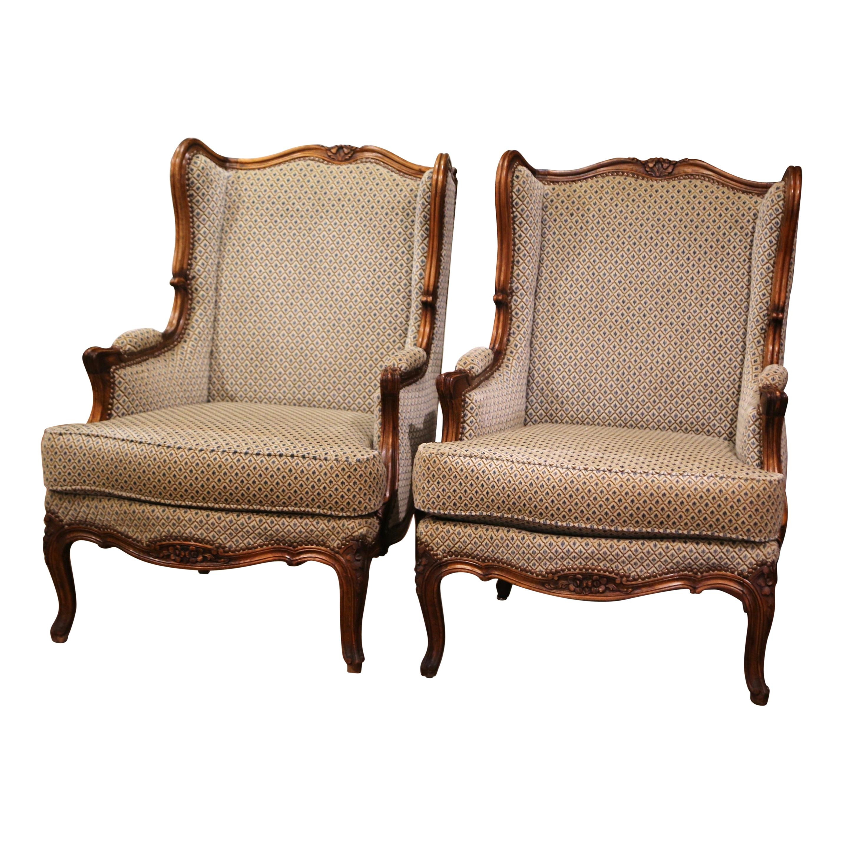 Pair of Early 20th Century Louis XV Provencal Carved Walnut Wing Back Bergeres