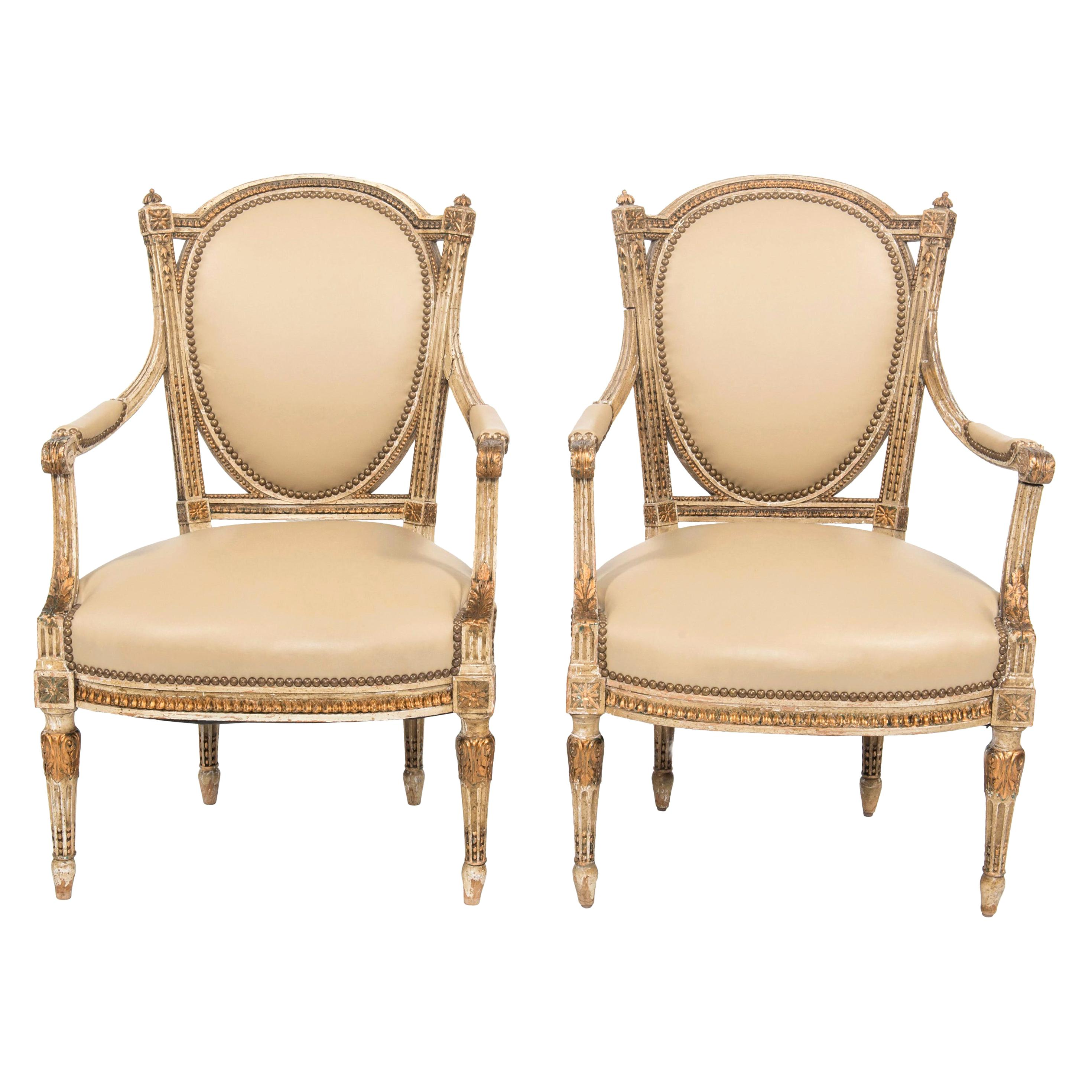 Pair of Early 20th Century Painted and Gilt French Louis XVI Style Fauteuils