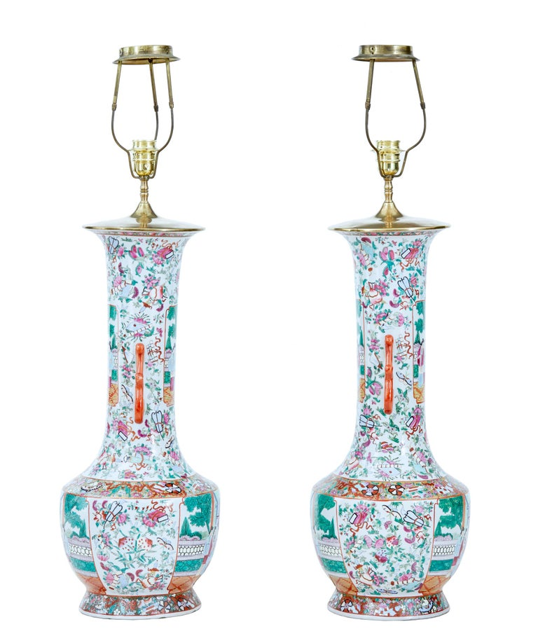 Pair of early 20th large Chinese Cantonese vase lamps, circa 1910.  Beautifully hand painted in green, pink and orange on a white background. These are a left and right pair and have always been a pair.  Later converted sympathetically into a