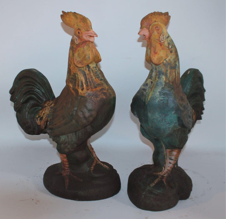 Pair of 20th century iron garden ornaments in original paint. Decorative and have great patina.