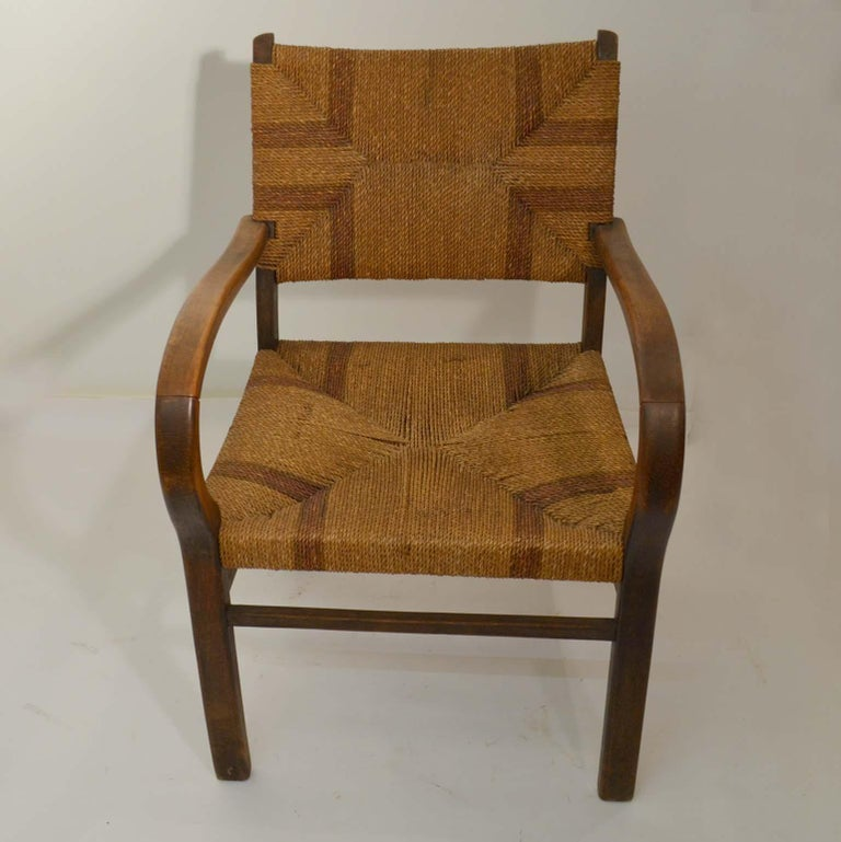 A pair of Bauhaus beech wood and two-tone woven seagrass rope armchairs, by Erich Dieckmann (1896-1944), circa 1925-1930. The use of quality hardwoods, rope and cane matting moderated the austere geometry of the designs and this pair with the