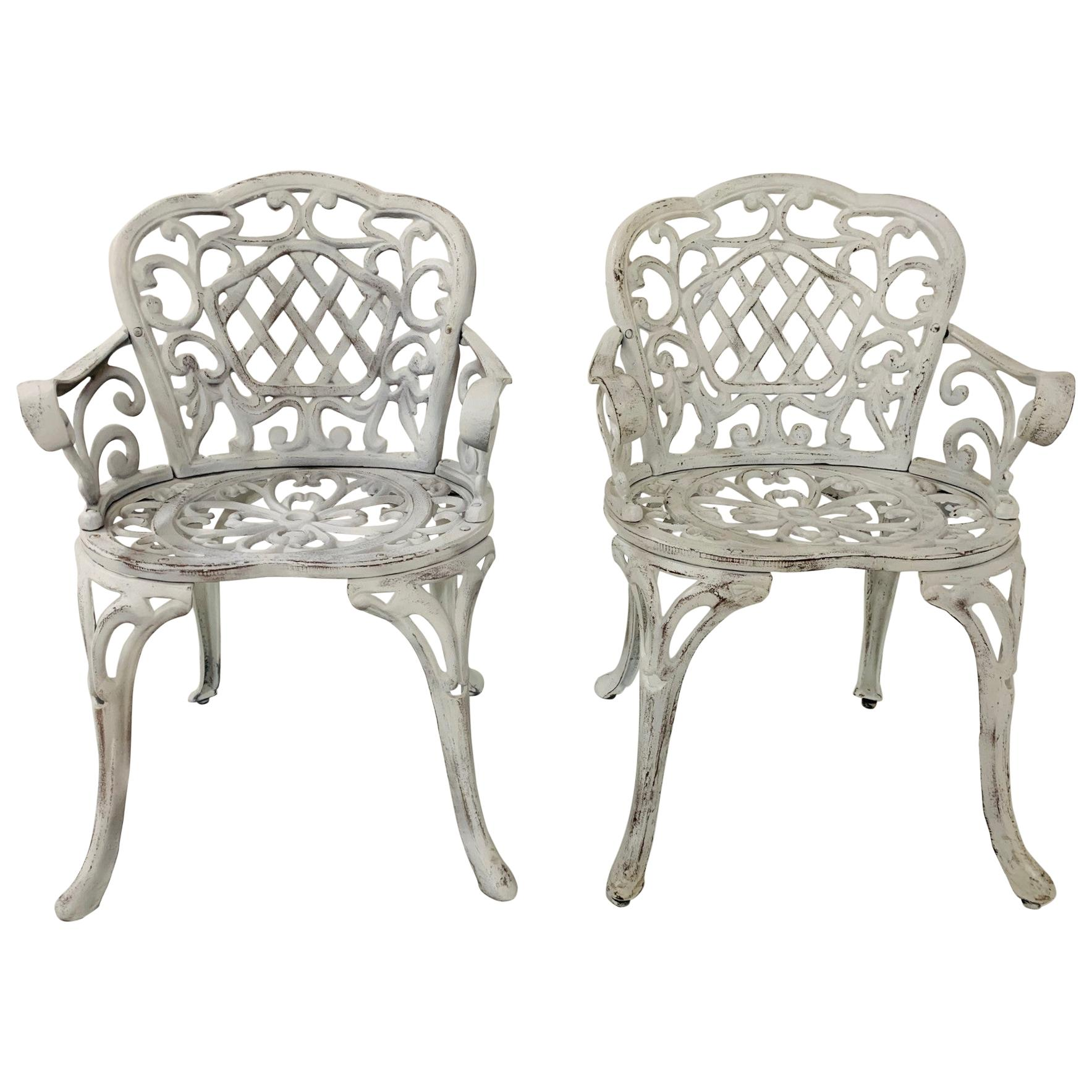 Pair of Early Cast Iron Garden Chairs